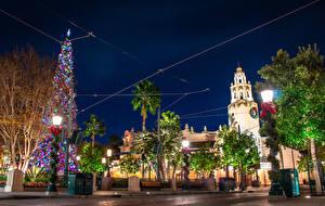 Картинка Рождество Штаты Диснейленд Парк Калифорнии Дизайна Ночные Уличные фонари Новогодняя ёлка город