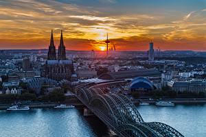 Обои Кёльн Германия Речка Мосты Собор Речные суда Рассветы и закаты Rhine город