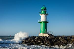 Фотографии Германия Волны Камень Маяк Warnemünde Lighthouse, Baltic sea
