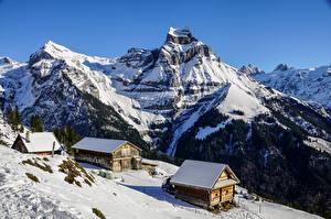 Картинки Гора Зимние Швейцария Здания Снегу Альпы Природа