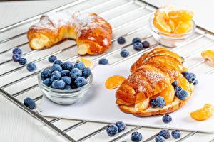 Картинка Выпечка Булочки Черника Сахарная пудра Апельсин Пища