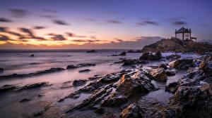 Фотография Рассвет и закат Берег Камни Португалия Capela do Senhor da Pedra Природа