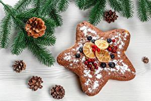 Фотография Рождество Печенье Ягоды Сахарная пудра Ветвь Шишка Звездочки Пища