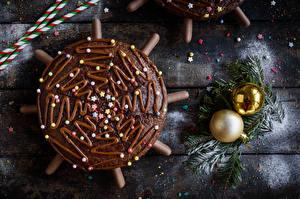 Фотография Новый год Пирог Шоколад Драже Доски Шар Продукты питания