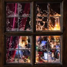 Фотографии Новый год Плюшевый мишка Свечи Окно Подарок Чашка