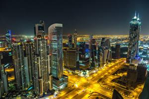 Фотография Дубай Объединённые Арабские Эмираты Здания Небоскребы Дороги Ночные город