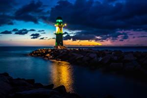 Фотография Германия Маяки Камни Море Вечер Rostock Природа