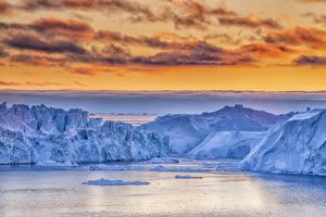 Картинки Гренландия Небо Айсберги Залива Скала Облака Природа