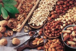 Фотография Орехи Много Грецкий орех Миндаль Фундук Продукты питания