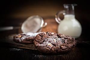 Фото Печенье Сахарная пудра Размытый фон Продукты питания