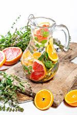 Обои Напитки Апельсин Грейпфрут Лимонад Кувшины Разделочной доске Еда