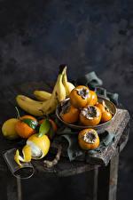 Обои Фрукты Бананы Лимоны Хурма Апельсин Натюрморт Продукты питания