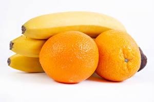 Фотографии Апельсин Бананы Белом фоне