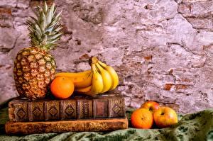 Картинка Натюрморт Ананасы Бананы Апельсин Яблоки Книги Еда
