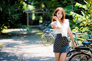 Картинки Азиатки Боке Юбки Блузка Рука Шатенки Смотрит