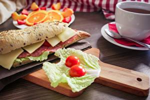 Фотография Капуста Сыры Колбаса Сэндвич Разделочной доске Продукты питания