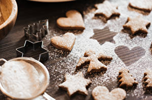 Картинки Печенье Сахарная пудра Ангелы Сердце Звездочки Ель Пища