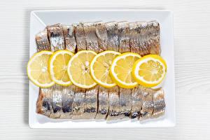 Фотографии Рыба Лимоны Нарезка herring Пища