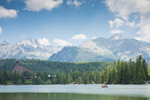 Обои Горы Леса Озеро Лодки Словения Tatra mountains Природа картинки