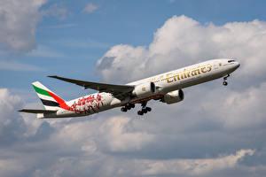 Фотографии Самолеты Пассажирские Самолеты Boeing Сбоку 777-300 ER, Emirates