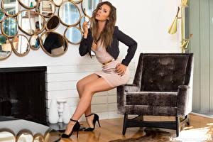 Картинки Playboy Gia Ramey-Gay Кресло Сидящие Ноги Красивая Платье Шатенка Взгляд молодые женщины