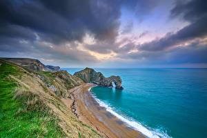Фото Море Берег Англия Скалы Облачно Durdle Door, Dorset Природа