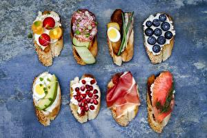 Фотографии Бутерброд Черника Рыба Гранат Колбаса Яйцо
