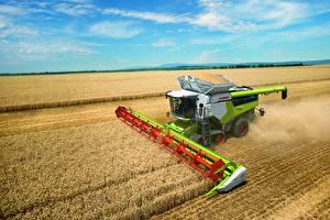 Фотография Поля Пшеница Зерноуборочный комбайн Сельскохозяйственная техника Claas Lexion 8700