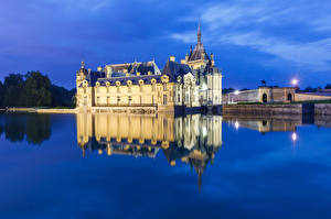 Картинки Франция Вечер Пруд Отражении Chateau de Chantilly город