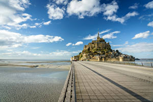 Фотография Франция Крепость Небо Море Облака Le Mont Saint-Michel Природа