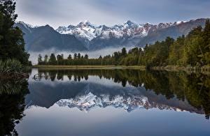 Картинки Новая Зеландия Гора Озеро Утро Отражение Деревья Lake Matheson Природа