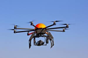 Обои Беспилотный летательный аппарат Квадрокоптер Летящий Углепластик Авиация
