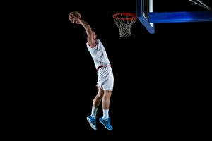 Фотографии Баскетбол Мужчина На черном фоне Прыгает Рука Мячик Униформе спортивные