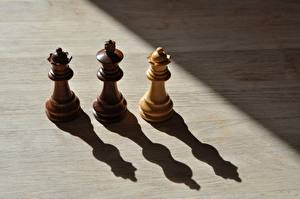 Картинка Шахматы Тень Втроем Из дерева