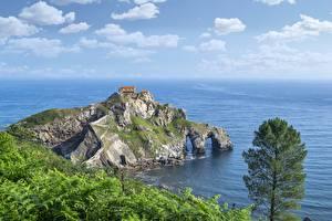 Картинка Берег Море Остров Испания Утес San Juan de Gaztelugatxe