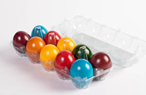 Фото Пасха Сером фоне Яйцо Разноцветные Пища