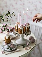 Фотографии Пасха Выпечка Свечи Сладости Рука Яйцо Дизайн Еда