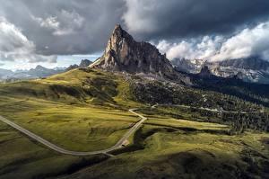 Картинки Италия Гора Дороги Облачно Passo Giau, Dolomites, Belluno Природа