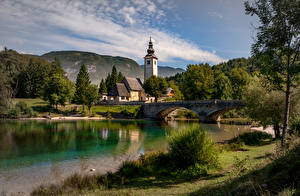 Фото Озеро Мост Словения Церковь Здания Triglav national Park, lake Bohinj Природа
