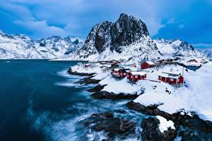 Картинка Норвегия Лофотенские острова Здания Горы Зима Утес Vestfjorden Природа