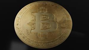 Фотография Вблизи Монеты Деньги Биткоин Золотые