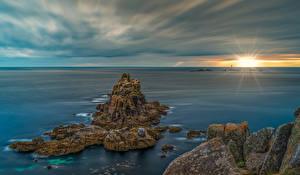 Фото Англия Рассветы и закаты Море Скале Cornwall Природа