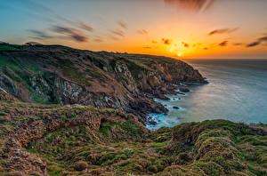 Фотографии Франция Рассвет и закат Побережье Утес Мхом Солнце Brittany Природа