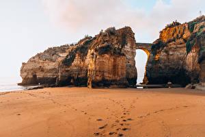 Картинки Португалия Мост Пляже Скала Ponta da Piedade Природа