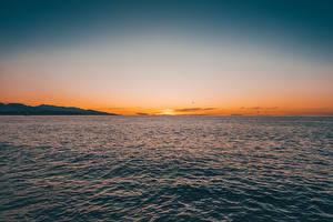 Картинки Рассвет и закат Море Горизонта