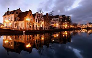 Фото Голландия Дома Реки Вечер Уличные фонари Haarlem Города
