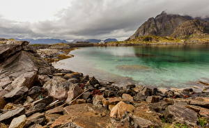 Обои Норвегия Лофотенские острова Горы Камни Облака Природа