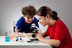 Обои Школьные Девочка Мальчик 2 Микроскоп ребёнок