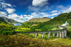 Картинки Шотландия Гора Небо Мосты Пейзаж Облака Glenfinnan, Lochaber, steam train
