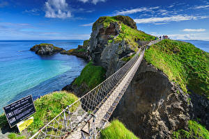 Фото Великобритания Берег Горы Море Мост Скалы Ballintoy, County Antrim, Northern Ireland Природа
